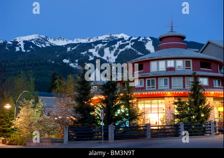 Whistler Village at Dusk with Blackcomb Mountain in the background - Stock Photo