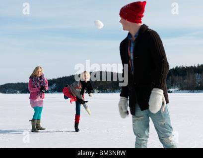 Friends having snow fight - Stock Photo