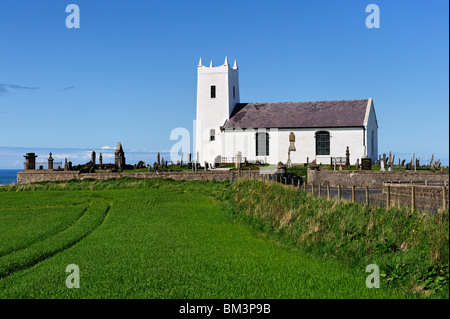 Ballintoy church on the North Antrim coast of Northern Ireland - Stock Photo