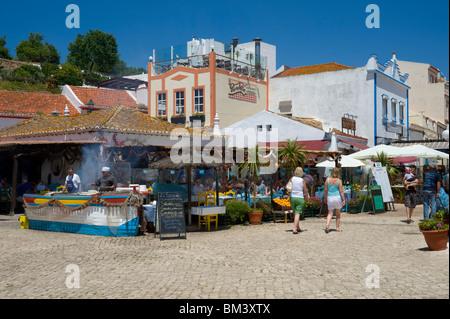 Portugal, The Algarve, Alvor Street Scene With Fish Restaurants - Stock Photo