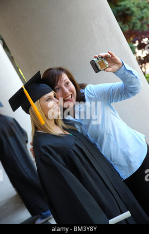 Graduate and mom taking photo together - Stock Photo