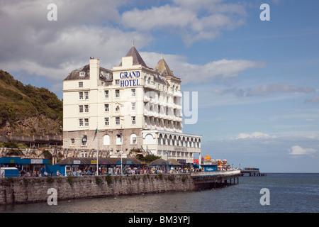 The Grand Hotel imposing Victorian building on seafront overlooking Ormes Bay in tourist resort on Welsh coast. - Stock Photo