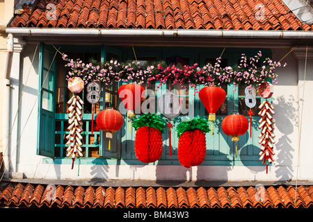 Chinese New Year decorations on a shophouse in Kampong Glam, Singapore - Stock Photo
