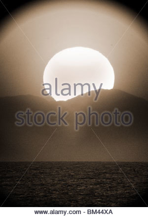 Sunset over Turkey photographed from Greece - Stock Photo