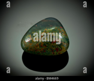 Cutout of a Heliotrope, or bloodstone gemstone on black background - Stock Photo