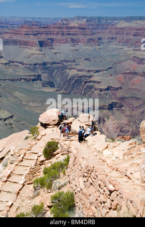 Hikers at Ooh-Aah Point on the South Kaibab Trail south rim Grand Canyon National Park Arizona USA  - Stock Photo