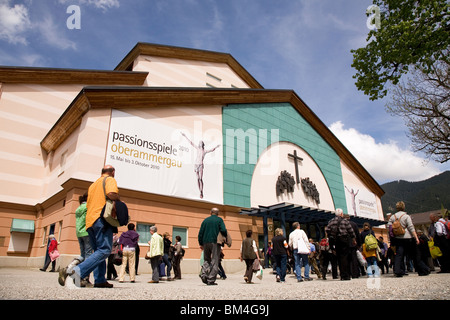 Spectators mill about outside of the Oberammergau Passion Play Theatre ahead of a 2010 performance. - Stock Photo