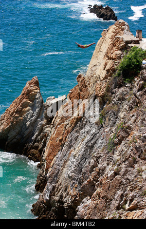 A popular sight are the young male divers (risking their lives daily for tourist tips )off the cliffs in Acapulco,Mexico. - Stock Photo