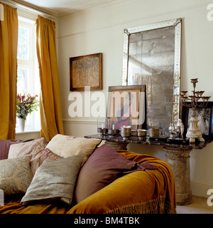 Antique mirror and console table in narrow cream hall with beige Stock Royalty Free Image