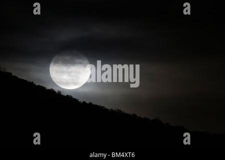 Full moon rises over the small mountain town of Salida, Colorado, USA - Stock Photo