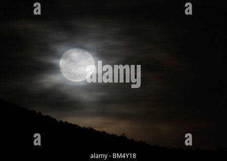 Full moon rises over the small mountain town of Salida, Colorado, USA - Stock Photo