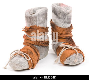 Poor mans shoes made of woolen stocking and rugs. Isolated on white. - Stock Photo