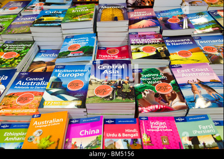 Lonely Planet travel guide books - Stock Photo