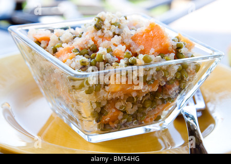 Protein rich quinoa grain salad made with sprouts and papaya. Topped with spicy dressing made with olive oil, herbs - Stock Photo