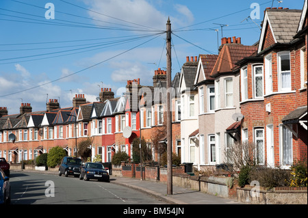 Row of terraced houses in residential Street, London, England, UK - Stock Photo
