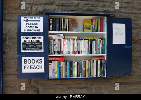 Selection of books for sale outside Backfold's bookshop in Hay on Wye in Powys Mid Wales - Stock Photo