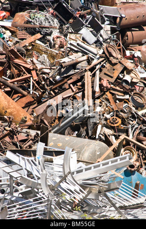 Large pile of scrap metal waiting to be sorted for recycling. - Stock Photo