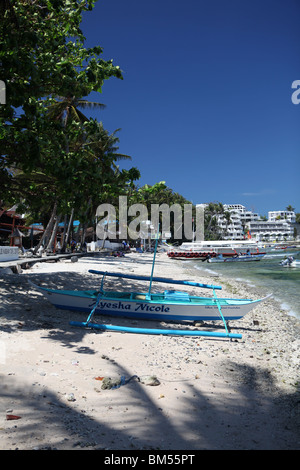 Small La Laguna Beach in Puerto Galera, located on the north of Mindoro Occidental in the Philippines. - Stock Photo