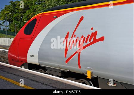 Virgin Trains Class 390 Pendolino 390 031 'City of Liverpool' departiing Oxenholme Station, Cumbria, England, U.K., - Stock Photo