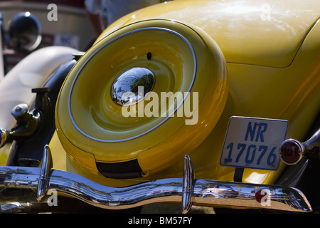 Close-up rear view of a yellow classic Ford roadster. - Stock Photo