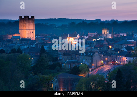Dusk in historic Richmond showing the floodlit castle North Yorkshire, England - Stock Photo