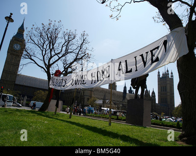 The Democracy Village, set up in Parliament Square on the 1st May is under threat from Westminster Council. - Stock Photo