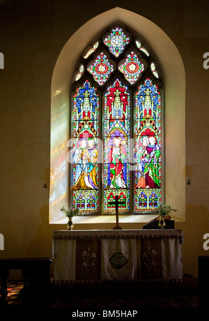 Stained glass window in St John the Baptist a typical English village church in Little Somerford, Wiltshire, England, - Stock Photo