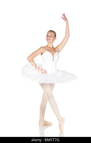 Young caucasian ballerina girl wearing a tutu on white background - Stock Photo