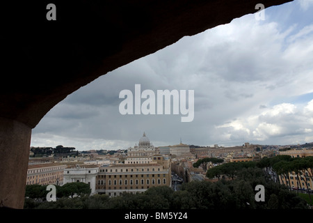 The dome of St. Peter's Basilica is seen through a window from the Mausoleum of Hadrian, know as Saint Angel Castle, - Stock Photo
