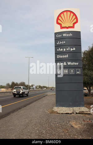 bilingual service sign of a Shell gas filling station near Muscat showing fuel prices, Sultanat of Oman. Photo by - Stock Photo