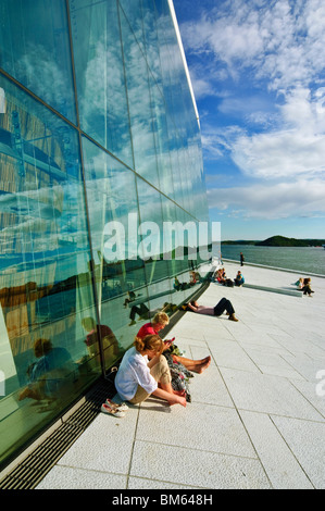 People relax outside Operaen the new Opera House (opened April 2008) in Oslo, Norway - Stock Photo
