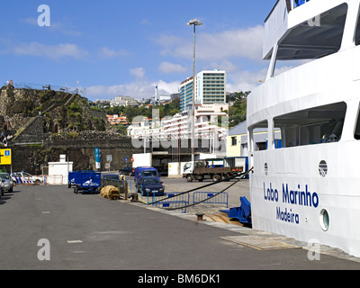 Lobo Marinho Porto Santo Ferry moored in the harbour close to Fort Sao Jose and hotels Funchal Madeira Portugal - Stock Photo
