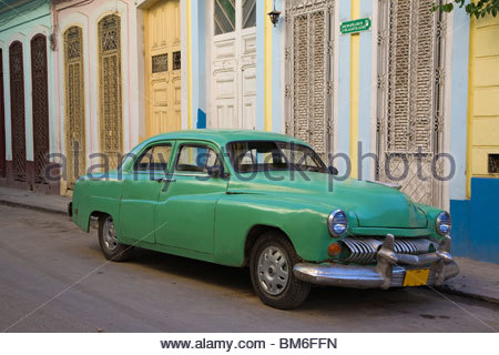 1950s car parked on dilapidated street - Stock Photo