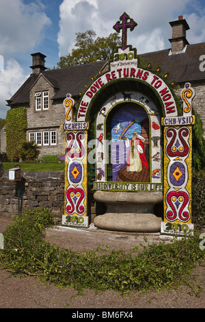 Well Dressing on the hands Well at Tissington, Peak District National Park, Derbyshire. - Stock Photo