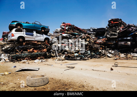 Quebec, Canada; Stacked And Crushed Automobiles At A Scrap Metal Recycling Yard - Stock Photo