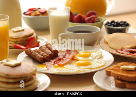 Breakfast, sausage, bacon, eggs, toast, coffee, cereal, fruit, toast and pancakes - Stock Photo