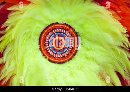Close up image of an American Indian feather bustle, with detailed beadwork. These bussles are used as dance regalia - Stock Photo