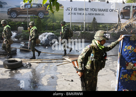 On May 19th, Thai soldiers at Chit Lom, Bangkok, in front of a BMW ad - Stock Photo