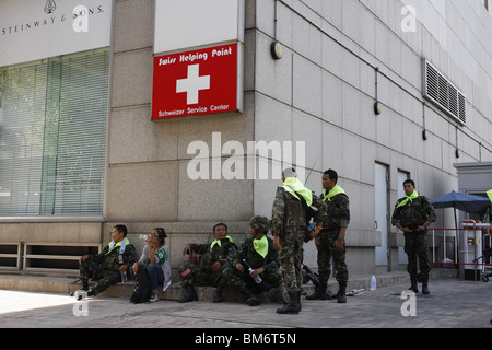 On May 19th, Thai soldiers rest in Chit Lom during a military assault on Red Shirt demonstrators - Stock Photo