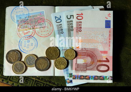 Turkish 90 day multiple entry visa in UK passport with entry and exit stamps Euro banknotes & coins Euros acceptable - Stock Photo