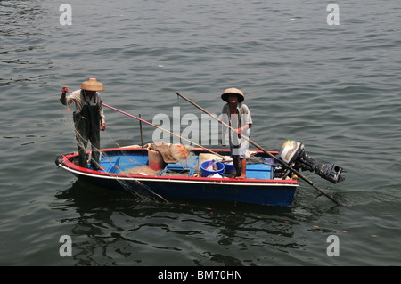 Line of small outboard motor fishing boats at dock at the for Small fishing boats with motor