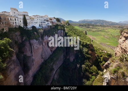 Ronda, Malaga Province, Spain. Part of the old city sitting on the edge of the Tajo gorge - Stock Photo