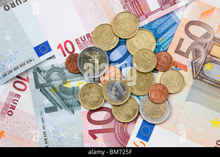 Euro notes and coins in various denominations from the European Union. Europe. - Stock Photo