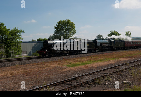 The Royal Wessex - Doubleheaded by LMS Class 5MT 44871 and King Arthur Class 30777 'Sir Lamiel' at Newbury Racecourse - Stock Photo