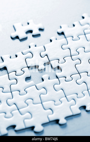 Jigsaw puzzle assembled with a piece missing - Stock Photo
