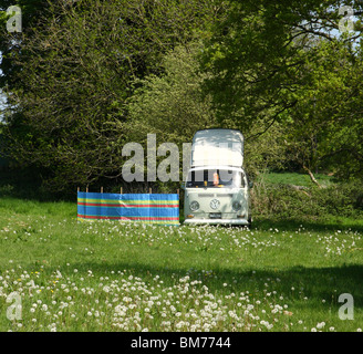 A VW campervan in the English countryside. - Stock Photo