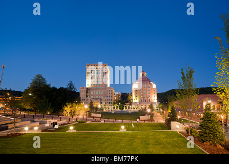 Downtown Asheville, North Carolina, NC. View of Art Deco architecture of City Hall and Court House building at dusk - Stock Photo