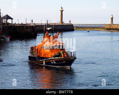 The Whitby Lifeboat 'George and Mary Webb' maneovering in the harbour in evening light - Stock Photo