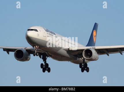 Lufthansa Airbus A330-300 long haul passenger jet plane flying on final approach. Close up front view. - Stock Photo