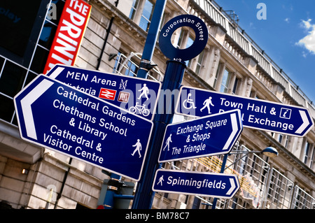 Signs for pedestrians on Corporation Street in Manchester city centre, England, UK - Stock Photo